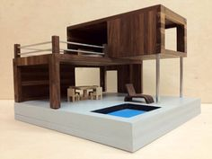 This modern doll house is entirely hand-built out of solid American walnut with brushed aluminum detailing. An ideal home for the action figure who values modern design. Designs, materials, and even mini furniture can all be customized. Building A Container Home, Container Buildings, Container Architecture, Casas Containers, Container Design, Container Cabin, Cargo Container, Modern Dollhouse, Shipping Container Homes