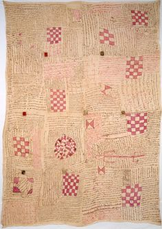 """Senegal? Talismanic Textile, Late 19th/early 20th century  Four panels joined: cotton, plain weave; painted; amulets of animal hide and felt attached...  """"The calligraphy is arranged in a fluid checkerboard pattern and organized around a series of painted shapes. The checkered motifs evoke magic squares, arrangements of numbers that, when added together in any direction, always amount to the same sum. Sufis view such numerological devices as a powerful reflection of divine mystery."""""""