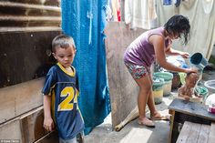 Seth, 6, at his home in the Hadrian slum, which he shares with 17 relatives.  Seth hopes to be a boxer one day
