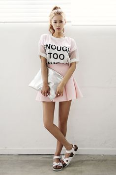 A crop top tucked into a A-line skirt