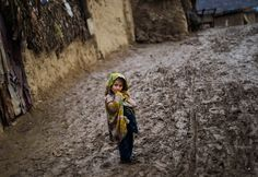 A Pakistani girl watches the photographer, while standing on the muddy path of a slum during a rainy day, on the outskirts of Islamabad, Pakistan Pakistani Culture, Pakistani Girl, Great Pictures, Cool Photos, Amazing Photos, Indus Valley Civilization, Slums, Worlds Of Fun, Afghanistan