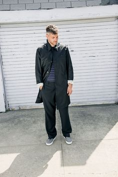 Prada nylon trench coat, Sunspel cotton T-shirt and Lanvin wool pants and canvas sneakers (Photo: Clement Pascal for The New York Times)