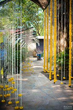We love the idea of decorating the wedding entrance with strings of marigold and mogra flowers. We love the idea of decorating the wedding entrance with strings of marigold and mogra flowers. Marriage Decoration, Wedding Stage Decorations, Wedding Entrance Decoration, Desi Wedding Decor, Aisle Decorations, Diwali Decorations, House Decorations, Birthday Decorations, Wedding Planner Book
