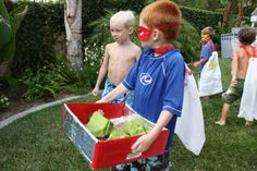 kryptonite hunt where the kids gathered all the sparkly green rocks that were spray painted days earlier and hid. They had to be carefully contained in the kryptonite case but the kids did it with the greatest of ease. Superhero Party Games, Superman Party, Superman Birthday, Superhero Classroom, Superhero Kids, Superhero Birthday Party, Birthday Fun, Super Hero Day, Butterfly Party