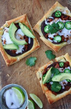 Easy puff pastry queso fundido pizza squares made with chorizo, beans, cheese and avocados. Top off with jalapenos for an added bite.