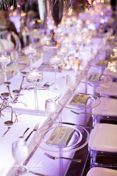 We adore these light up tables and clear chargers. It gave our Regency Ballroom such a unique look!