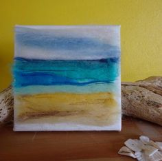 A personal favourite from my Etsy shop https://www.etsy.com/uk/listing/518822749/beach-canvas-needle-felted-beach-scene