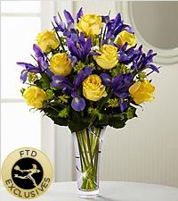Sunlit yellow roses are arranged with deep purple iris and lush greens, presented in a lavender designer glass vase via frugal flower Purple Yellow, Yellow Flowers, Silk Flowers, Purple Iris, Deep Purple, Orange, Deco Floral, Arte Floral, Spring Bouquet
