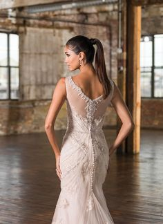 A geometric beaded pattern adorns this Signature fit and flare gown with a Sabrina neckline, natural waistline, and chapel length train with hem lace. https://www.justinalexanderbridal.com/signature_wedding_dresses/9825?crlt.pid=camp.B6frWPYg7SOB