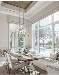 Loving this full banquet seating under a bank of large windows - classy dining space overlooking a great pool view and backyard. Summertime living at its best! Are you Home yet? Banquette Seating In Kitchen, Dining Nook, Dining Room Paint, Dining Room Design, Banquettes, Home Decor Kitchen, Kitchen Nook, Decoration, Sweet Home