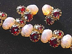 Opal and Garnet set attributed to Hattie Carnegie / circa: 1960-70s