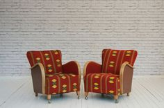 A pair of 1930's German oak framed armchairs upholsteted in vintage As – White Elephant Trading Company