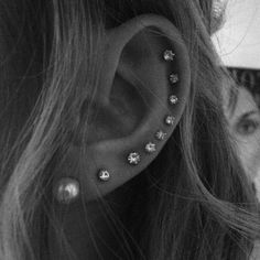 i wish i was brave enough to do at least half this many. i don't know if i like the whole ear part, but i definitely love the look of multiple piercings all in a row.