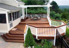 composite deck with white railing and pergola