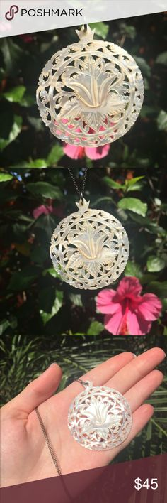 """Bohemian vintage flower necklace mother of pearl NEW never worn. Hand carved from Israel, vintage mother of pearl necklace featuring a flower. Intricate filigree design background and nice detail on flower. Perfect bohemian necklace Large size, comes with chain! MOP  🌵☀️OFFERS / BUNDLES WELCOME☀️🌵  Pendant measures approximately 2"""" across.  Chain drop measures approximately 9"""" Jewelry Necklaces"""