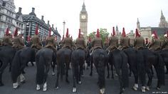 Mounted soldiers take part in a full dress rehearsal of a carriage procession between Westminster Hall and Buckingham Palace