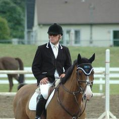 Hayward sponsored rider HUGH GRAHAM is wearing our black machine washable jacket with white 1/2 Ribbon on the collar and white trim on the pockets.