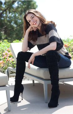 Anne Hathaway skinny jean and thigh high stiletto boots