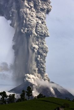 A column of ash collapses into a pyroclastic flow above Mount Sinabung near Tigapancur village in the Karo district in Medan, Sumatra, Indo...