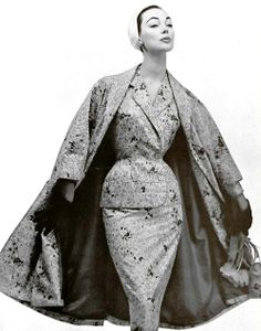 Ivy Nicholson in a satin suit & coat by Nina Ricci, photo by Louis Astre, 1955.