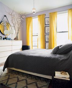 If your home is feeling tired, but you don't have the time or resources for a major makeover, then you need to try these supersimple room refreshers. Bright yellow curtains add a pop of cheery color to this grey bedroom Yellow Gray Bedroom, Grey Bedroom Design, Grey Room, Bedroom Colors, Bedroom Designs, Bedroom Black, Lilac Bedroom, Yellow Room Decor, Bedroom Apartment