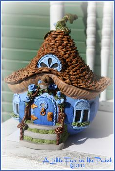 "how to make a polymer clay fairy house | The Blue Fairy""'s house is off to New Mexico later this week! tide pod container....."