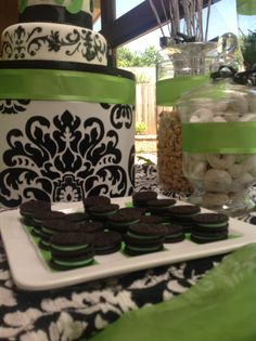 Lime green, black & white damask candy and dessert buffet for a baby girl shower. Styled by B Nspired Designs (BND). Oreos with green filling.