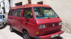An old van with decorating by party. This is one of the most classic models of Volkswagen van.