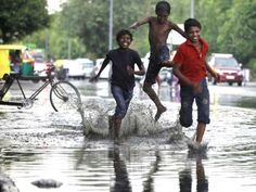 Street kids enjoy the pre monsoon rain that brought relief from high temperatures in Delhi. (Raj K Raj/Hindustan Times)