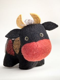 This handsome bull is handmade in Kyrgyzstan out of felt, a thick fabric produced by application of heat, water, and pressure for the meshing together of wool f