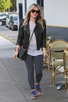 A laid back look we love: moto jacket, sneakers and leggings. #HilaryDuff