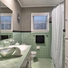 Vintage green tile bathroom. When we finally decided to keep it, this is how it turned out.