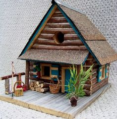 """Log house birdhouse  12"""" tall  Hand made at Backwater Studio with love to last.  Details at this link:  http://www.backwaterstudio.com/log-house-birdhouse.html"""