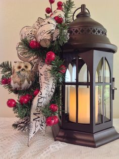 """Metall lantern 4"""" candle ,owl ,Merry Christmas bow ,red berries , small pine cones . L119.  2016. $65.00. Sold"""