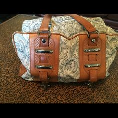 Balenciaga paisley print & leather shoulder bag Balenciaga paisley print and brown leather shoulder bag in perfect condition!  Used once and no signs of wear!  From the fall/winter collection a couple of seasons ago.  This bag is perfect for autumn!  Less expensive through PP Balenciaga Bags Shoulder Bags