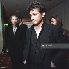 Actor Sean Penn, followed by Carolyn Bisset (L), wife of John F. Kennedy JR. (far L), leaves after the White House Correspondent's annual dinner in Washington, DC, 01 May, 1999. Penn was Kennedy's guest, the Publisher of George Magazine. The event was attended by numerous celebrities. AFP PHOTO/Manny CENETA