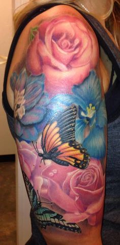 colorful flower and butterfly tattoo half sleeve