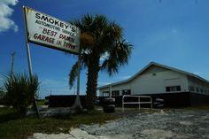 smokey yunick daytona beach | Caption: The sign at Smokey Yunick's Garage Monday, June 16, 2003, in ...