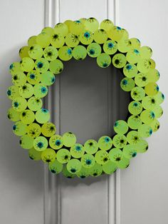 Delight trick-or-treaters by decorating your front door with these 12 easy-to-make wreaths.