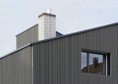 Haus Bergé is a minimal design created by German-based firm KHBT. The timber-clad panels are wrapped along an inclining roof, all of which sits atop a stone foundation. The roof shape was developed through a continuation of the existing double monopitched roof. On the ground floor, the brick walls are left completely exposed while the upper floor walls are covered in water-resistant mineral coating. (2)