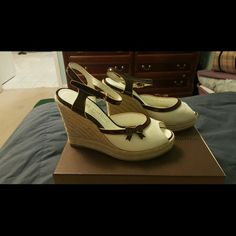 """Authentic Louis Vuitton cream colored wedge heels Authentic Louis Vuitton wedge heels 4"""" in cream color with brown leather trim and straps. Size 37. Only worn once.   Selling only. No trades. Thanks for looking! Louis Vuitton Shoes Heels"""