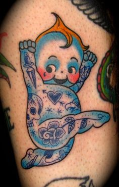 Blue Kewpie. I love this. Crazy fun & cute. This little Kewpie Doll is tatted up!