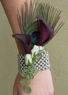 Wrist corsage peacock feather and purple calla lilies