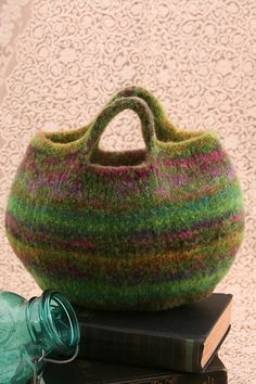 Cool felted purse. make in huge size with double strands of only two play wool make for holding projects or beach(line with plastic)