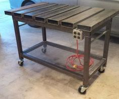 "This is a welding table that I designed with inspiration from many different tables that I found on a variety of sites. I wanted a table that would be easy and inexpensive to build, have clamp access anywhere on the top, and have a flat working surface. This is what I came up with! It is made from 11 gauge (1/8"") rectangular tubing in three sizes: 6"" x 2"", 3"" x 2"", and 2"" x 2"". I decided to use 6"" x 2"" tube because it was much less expensive and 2..."