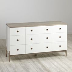 Our Wrightwood 9-Drawer Dresser has made it easier than ever to create the right look right away for any room in your home.  The stunning, two-tone stained grey and white finish allows the dresser to coordinate with your other furniture and decor, while still standing out on its own.  It features nine spacious drawers, so it's as practical as it is stylish.  Plus, it's arranged in a unique, functional 9-drawer configuration.