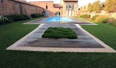 Wide open space w/ a pool and grass.