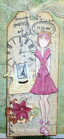 Julie Nutting doll stamp, postage stamp, tag and flowers by Prima, Typewriter die cut by Tim Holtz, word stamps by My Sentiments Exactly! Clock stamped image by Paper Inspirations.