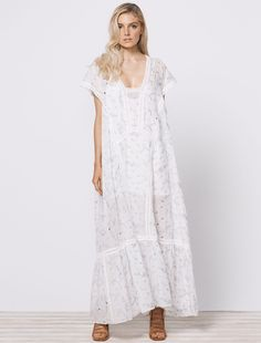 MELROSE MAXI DRESS This billowing maxi dress has been crafted from a breezy linen blend, embellished with an embroidered floral design with delicate broderie anglaise detailing, inspired by a vintage tile discovered on our travels. Designed with a wide open neck, and wide short sleeves, this carefree dress incorporates crochet lace trim to create beautiful panel lines that enhance the bohemian feel of this piece. Available now at www.steviemay.com.au