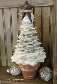 "Organized Clutter- paper tree    ""Thomas Nelson's note: Have a book that's falling apart? Make it ""grow"" with this Christmas tree craft!..."" @beckyhallberg something to do with all Picasso's paperwork one day. I suspect you'd have an entire forest of these. Lol!"